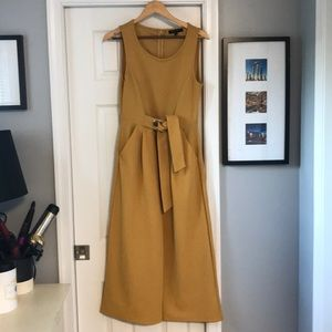Boutique Mustard stretch jumpsuit with pockets